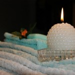 candle on towels